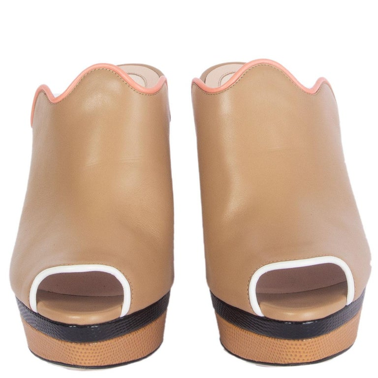 100% authentic Fendi chunky platform mules in beige, rose, white and black leather. Block heel and the iconic wavy trim. Embossed sole and heel. Have been worn and are in excellent condition.   Measurements Imprinted Size41 Shoe Size41 Inside
