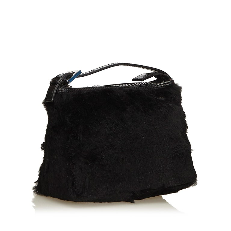 This handbag features a fur body, a flat leather strap, and a top zip closure. It carries as AB condition rating.  Inclusions:  Dust Bag  Dimensions: Length: 16.00 cm Width: 19.00 cm Depth: 4.00 cm Hand Drop: 3.00 cm  Material: Natural Material x