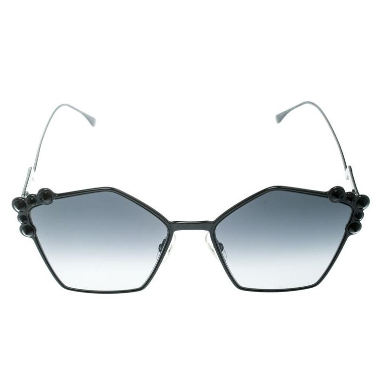 The stylish geometric silhouette is combined with gorgeous stud applications on the contours and amazingly carved metal temples, to make these Fendi sunglasses one of a kind and super fashionable. From the silhouette to the classic black hue,