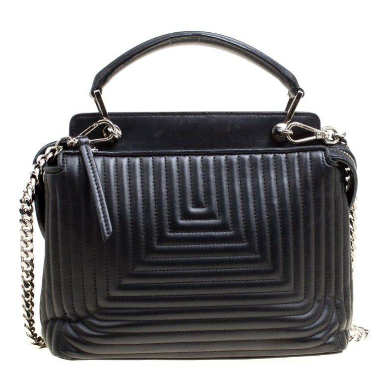 We are in love with this Dotcom bag from Fendi. Breathtakingly crafted from leather, the bag has a silhouette that will have people drooling. It has a quilted exterior, and the top zipper reveals suede interiors capacious enough to carry your