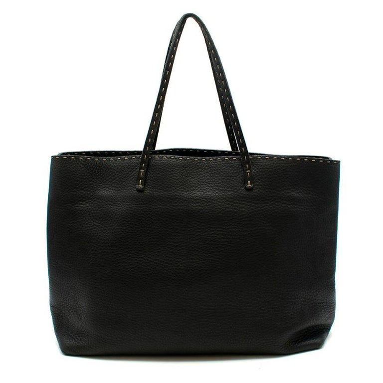 Fendi - Black Selleria Leather Tote Bag  - contrast visible stitch trim  - double top handle  - open  - zip closure pocket inside  - metal embossed plaque inside - two slip pockets inside  - leather outer, suede lining    Please note, these items