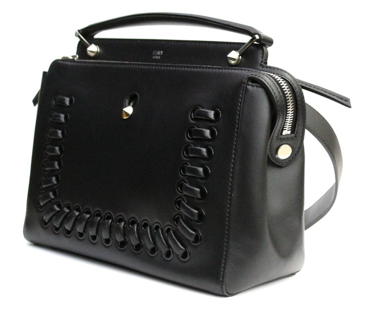 The Dotcom bag is one of Fendi's newest creations. This stunning bag is crafted out of smooth calfskin leather and has a modern structured shape. This chic bag has two compartments, divided by a stiff partition. Both sections have a zip closure and