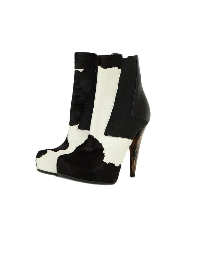 Fendi Black/White Calf Hair Bootie sz 37.5  Made In: Italy Year of Production:   Color: Black, white Materials: Leather, calf hair Closure/Opening: Slip-on Overall Condition: Excellent pre-owned condition, with the exception of some minor external