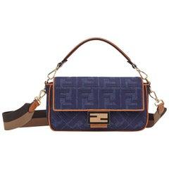 Fendi Blue Denim Embossed Monogram Baguette Bag w. Strap rt. $2,590