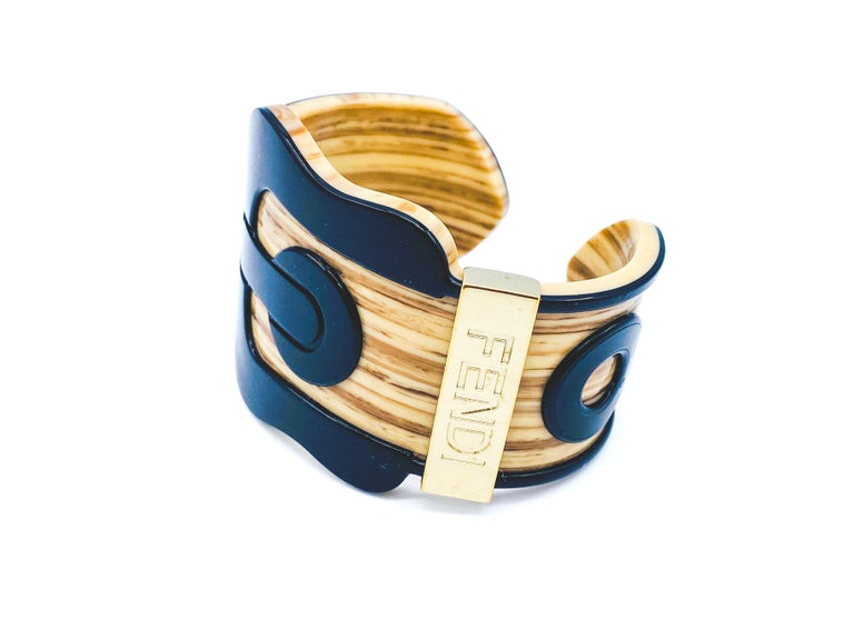 Fendi Bracelet Vintage Buckle Cuff  Fantastic statement piece from the iconic House of Fendi  Detail -Made from a tan coloured sturdy acrylic -Black acrylic buckle -Silver coloured base metal Fendi plate  -Slides on and off  Authenticity &