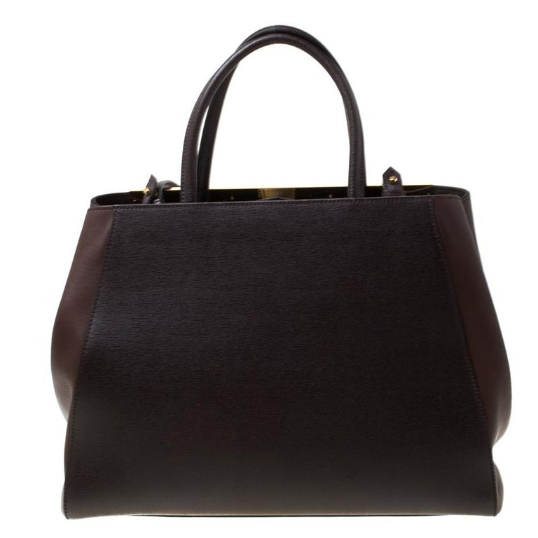 Fendi's 2Jours tote is one of the most iconic designs from the label and it still continues to receive the love of women around the world. Crafted from brown leather, the bag features double rolled handles. It is also equipped with a fabric interior