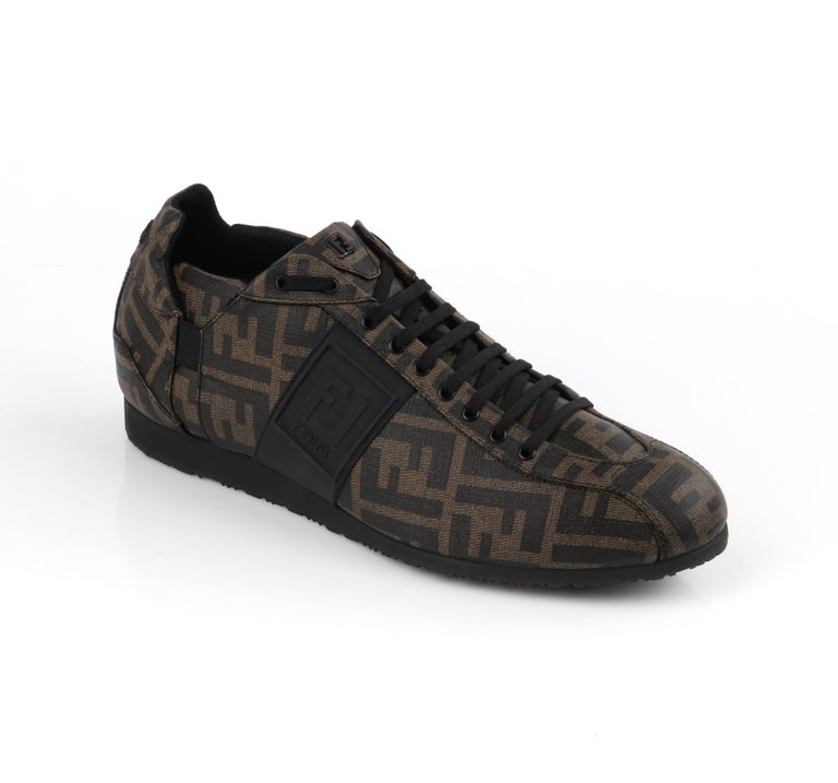 FENDI Brown Zucca Monogram Coated Canvas Logo Mens Low Top Sneaker Shoes   Brand / Manufacturer: Fendi Designer: Karl Lagerfeld Style: Low top sneakers Color(s): Shades of brown, black (exterior, interior) Unmarked Fabric Content: Coated canvas