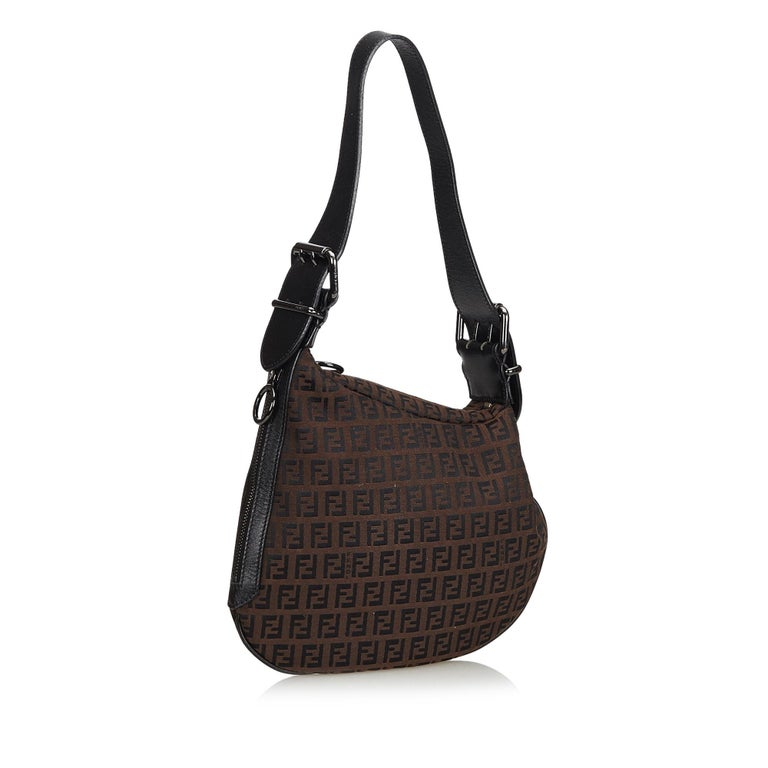 This hobo bag features a jacquard body, adjustable flat shoulder strap, and an exterior zip pocket. It carries as AB condition rating.  Inclusions:  This item does not come with inclusions.  Dimensions: Length: 23.00 cm Width: 25.00 cm Depth: 4.00