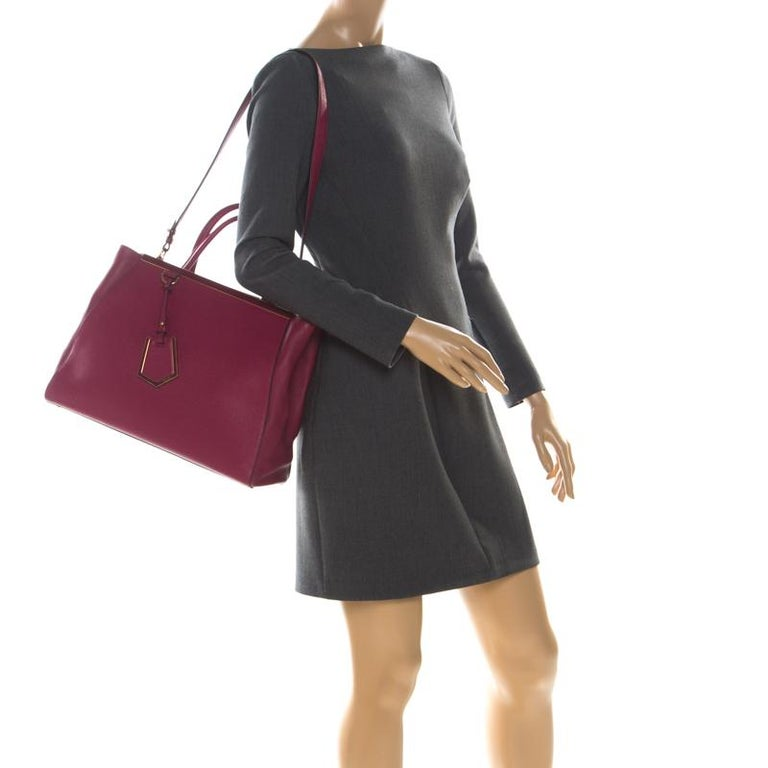 Fendi's 2Jours tote is one of the most iconic designs from the label and it still continues to receive the love of women around the world. Crafted from burgundy leather, the bag features double rolled handles. It is also equipped with a fabric
