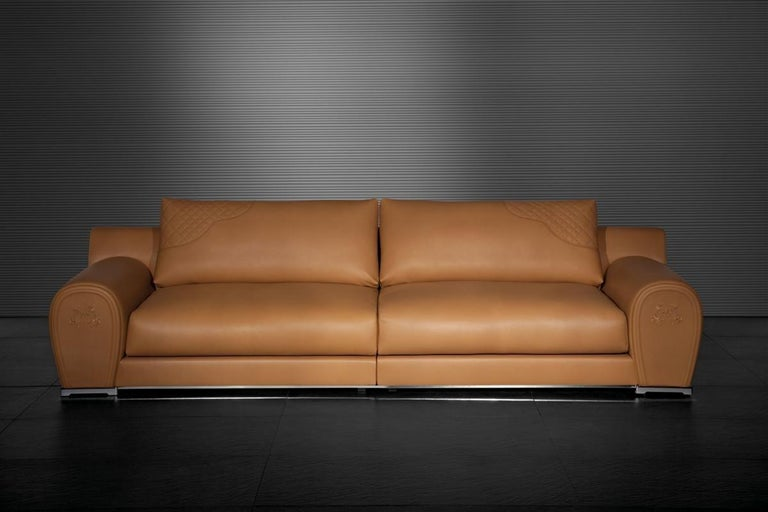Double Varenne modular cognac saddle leather sofa from the iconic Italian fashion house of Fendi, featuring lush, buttery soft leather, quilted accents and embossed Fendi horses. Stainless steel base, steel and wood frame, foam and down fill and the
