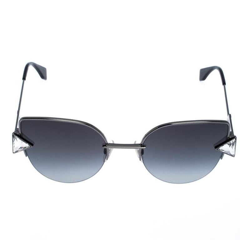 The stylish frame sculpted into a cat-eye shape and crystal accents on the sides make these sunglasses a high-fashion accessory that you must own. From the house of Fendi, they will look best with your daytime statement outfits.  Includes: The