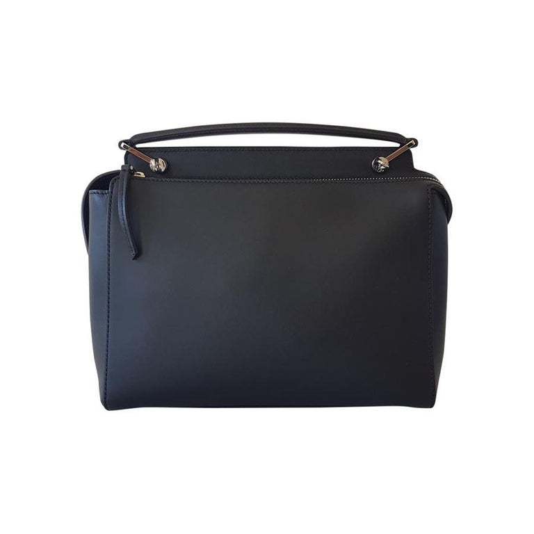 Fantastic and brand new Fendi bag Leather Black color Salmon inserts Can be carried by hand or on shoulder Double zip closure Frontal embsossing Removable pochette, in salmon leather Metal studs Suede internal Two internal pockets Cm 33 x 23 x 12