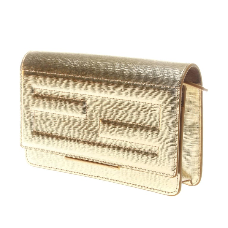 Fendi gold metallic calfskin wallet on chain (WOC). Tube design featuring FF stitching to front flap.   The interior has handy gusseted compartments, flat pockets and six credit card slots. Long detachable chain shoulder strap and gold metal ware.