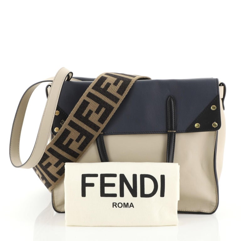 This Fendi Flip Grace Convertible Tote Leather Regular, crafted in neutral leather, features fold-over flat top handles, shoulder strap and gold-tone hardware. It opens to a gray microfiber interior with slip pockets.   Estimated Retail Price: