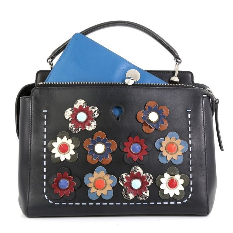 This Fendi Flowerland DotCom Convertible Satchel Embellished Leather Medium, crafted from blue leather, features a flat top handle, studded Flowerland flower appliqués, distinctive conical stud embellishment, and silver-tone hardware. Its extended