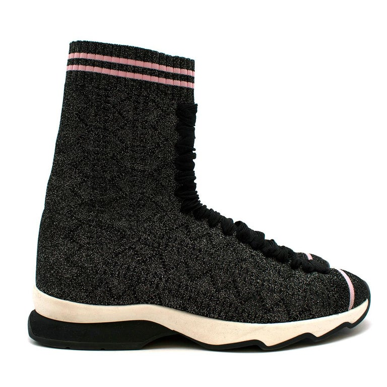 Fendi Grey Lurex Sock Trainers   The high-top knit sneakers come with a lace-up detailing and a tonal pattern knit throughout. The metallic black iteration comes with pink detailing, contrasting against the glittery material.  Materials: knit and