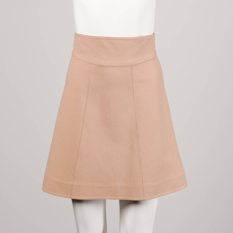 Stunning blush pink avant garde jacket and skirt ensemble by Fendi. Unique 3/4 length sleeves and double breasted buttons on the jacket. A-line cut on the skirt. Wear together or as separates!  Details:   Unlined Skirt: Back Zip and Button/ Jacket: