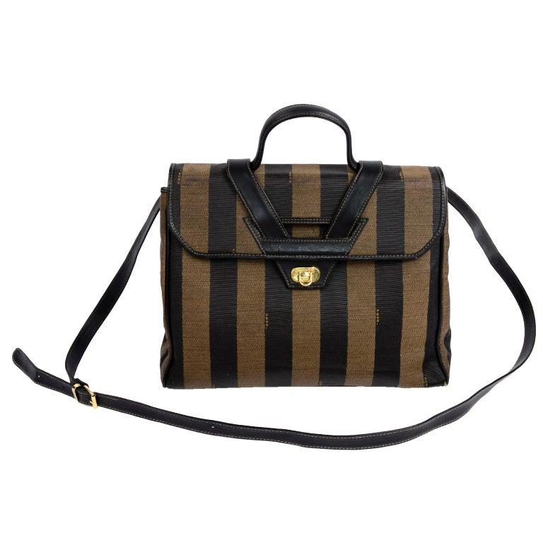 We love this fabulous Fendi Monogram Stripe bag with a top handle and optional shoulder straps.  This wonderful handbag measures 12