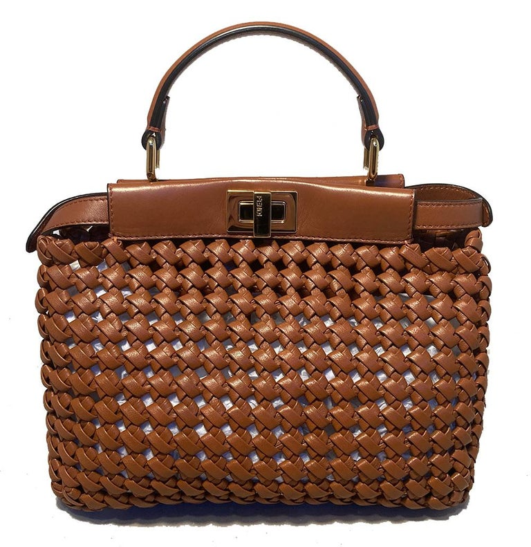 Fendi Brown Leather Interlace Iconic mini Peekaboo Tote in New without tag condition. Tan basket woven leather exterior trimmed with gold hardware. Removable matching leather shoulder strap. Top twist lock closure opens to an unlined interior with