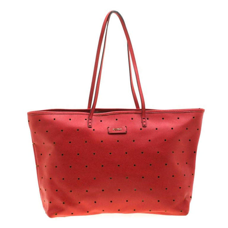 Fendi's Roll bag is simply breathtaking. Crafted from perforated red leather, this tote is striking and stylish all in one! It features comfortable double top handles and a Fendi plaque in gold-tone hardware on its front. Its interior is lined with
