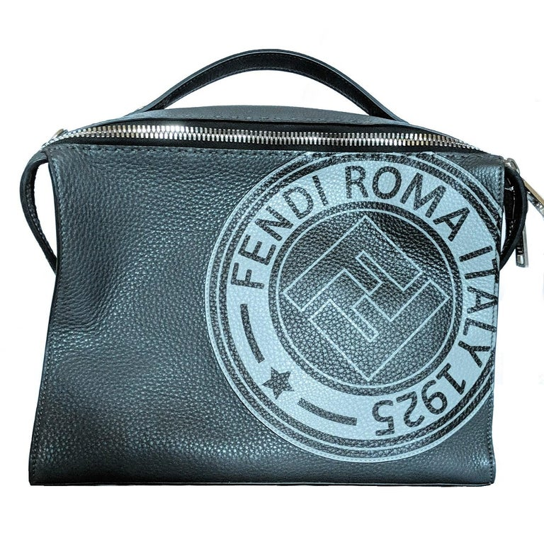 Rectangular-design bag, a detachable and adjustable shoulder strap, black and grey textured calf leather with a cotton-blend logo printed on the front, double zip closure opens to a black fabric interior with a zipper and patch pockets, silver-tone