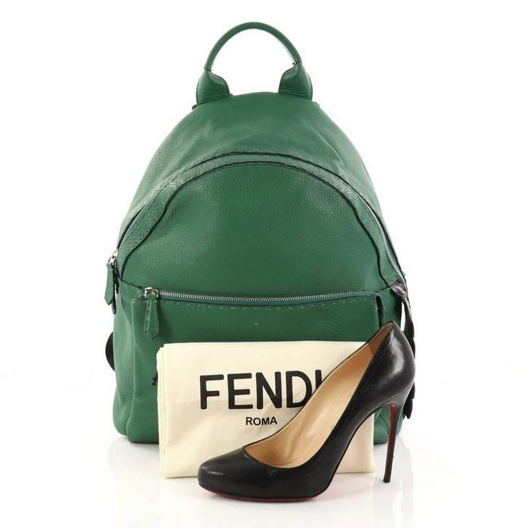 This authentic Fendi Selleria Backpack Leather with Crocodile Embossed Tail Medium balances a luxurious, playful style made for on-the-go fashionistas. Crafted from green leather, this backpack features a flat top handle, padded, adjustable shoulder