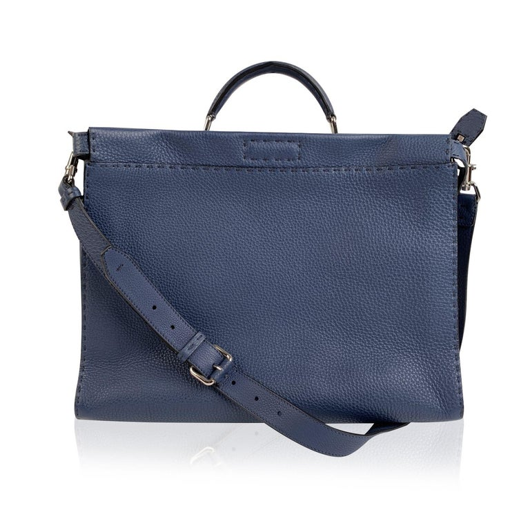 This beautiful Bag will come with a Certificate of Authenticity provided by Entrupy. The certificate will be provided at no further cost.  Beautiful Fendi Selleria 'Peekaboo Iconic Medium' tote bag in light blue pebbled leather. The bag features 2
