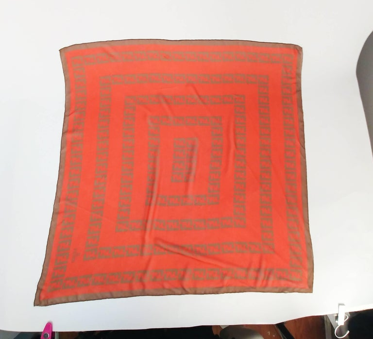 Fendi Silk Chiffon Printed Logo Scarf. Orange and brown printed chiffon scarf. Hand-rolled edges.