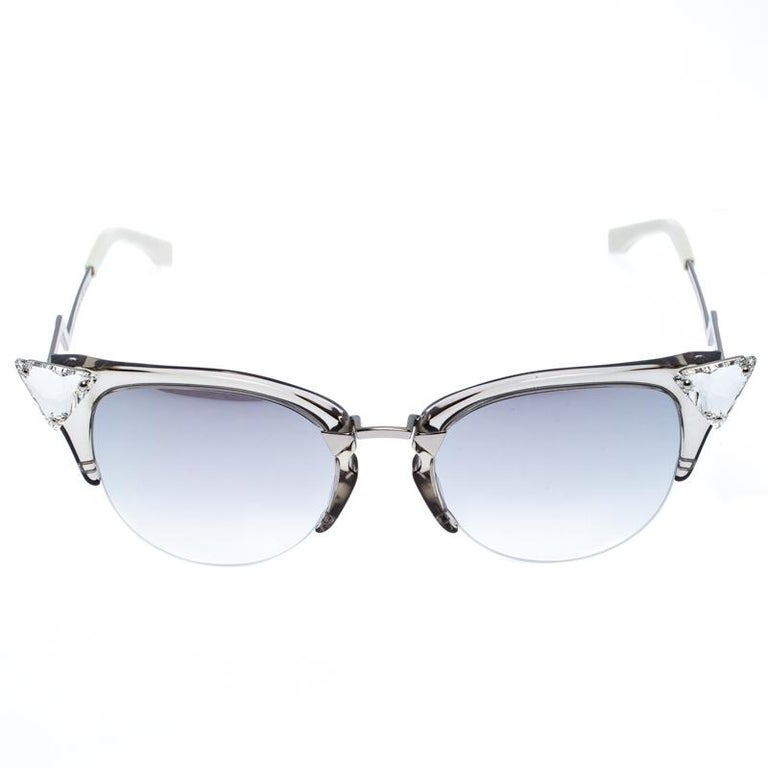 Futuristic and uber edgy, this pair of sunglasses by Fendi is a buy you won't regret. It's so stylish, it'll effortlessly represent the fashionista in you. Made of acetate and silver-tone metal into a cat-eye shape, the piece has crystal accents on
