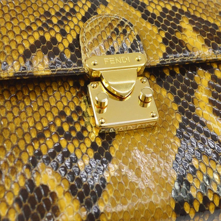 Snakeskin Gold tone hardware Leather lining  Push lock closure Date code present Made in Italy Shoulder strap drop 16