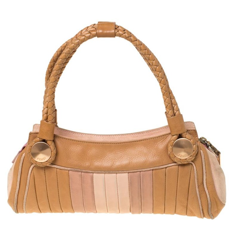 This functional bag can be used for work and off-duty looks. Crafted from leather, the bag is high on style. This bag has a suede-lined interior ideal for your essentials. This Fendi handbag is equipped with braided handles and rose gold-tone