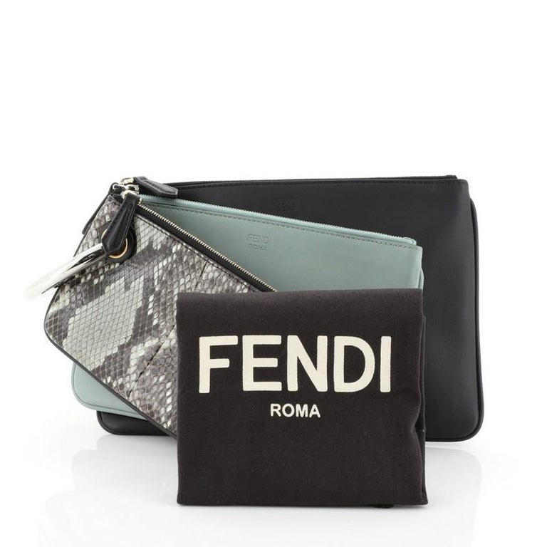 This Fendi Triplette Pouch Set Python, crafted in genuine black and green leather and python skin, features a Fendi logo ring clip handle and silver-tone hardware. Its zip closures open to a black fabric interior. This item can only be shipped