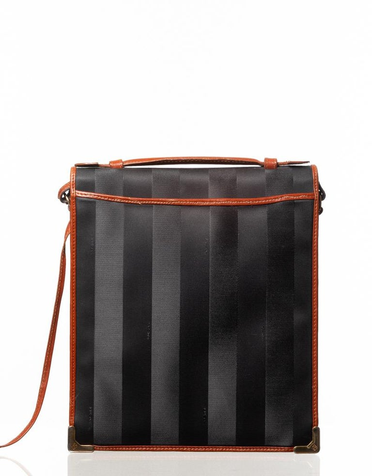 Fendi Midnight Navy Blue Striped Coated Canvas with leather finishing a circular FF logo and Fendi marked buckle. Vintage - Minimal signs of wear. Made in Italy. Vendor Code 2171 1930 019  COLOR: Midnight Navy MATERIAL: Coated canvas with leather