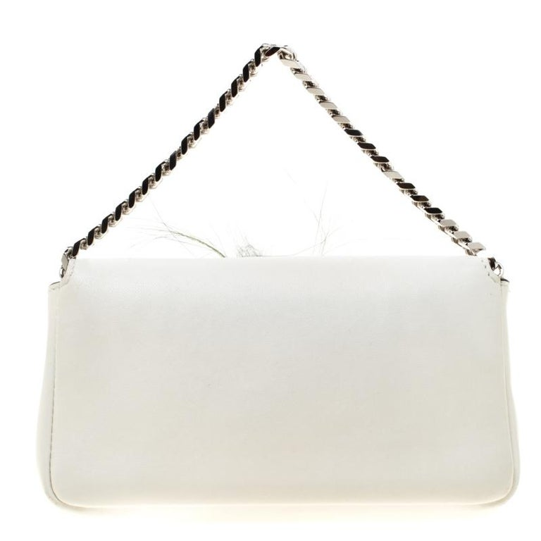 Carry this Fendi Micro Monster baguette and garner admirable glances as you march along. The bag is crafted in white leather embellished with crystals. It features a silver-tone link chain and FF hardware logo. To create an exclusive Fendi monster