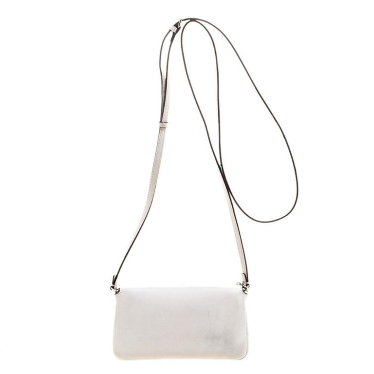 The Monster Baguette bag from Fendi comes with a unique twist. The front flap features embellishments along with the striking Forever lock in silver tone. Crafted from white leather, it has a suede lined interior sized to hold all your essentials.