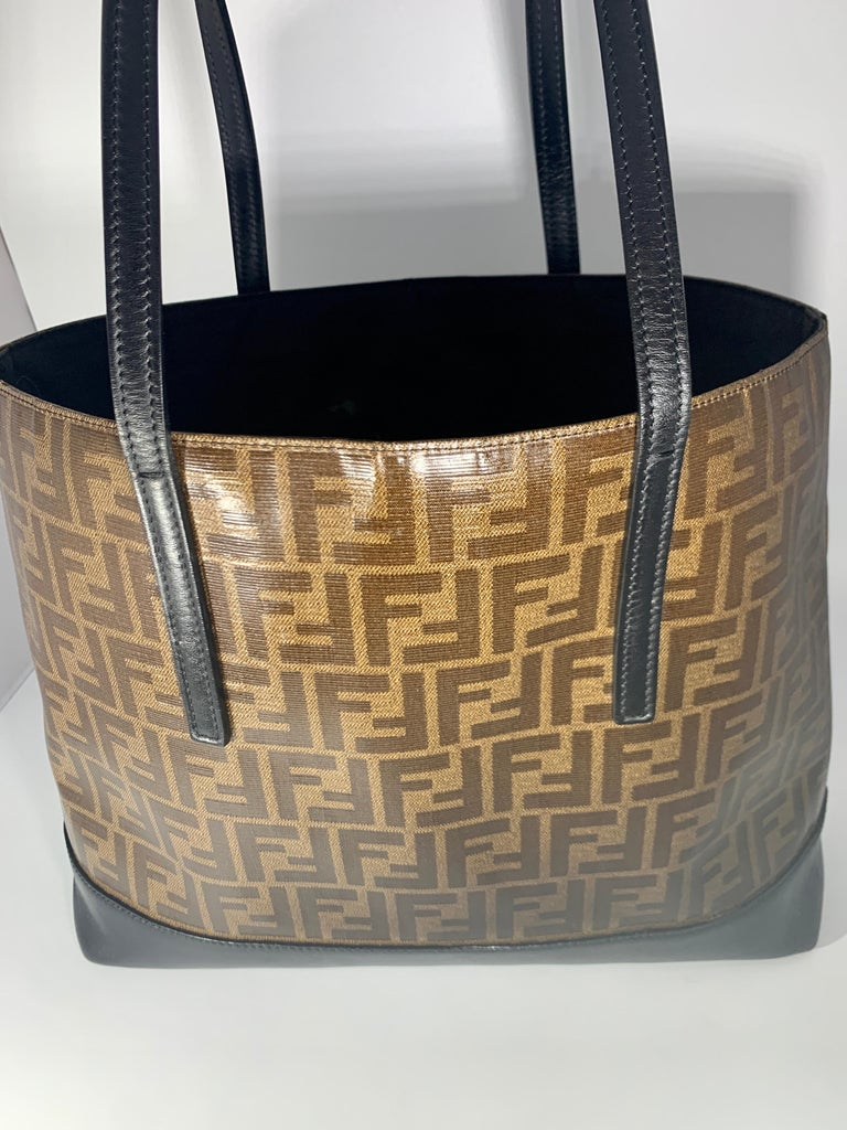 Fendi FF  Logo Print  Neverful Tote Bag - Women - Leather/ Coated  Canvas, Brown/Black Brown FF print tote bag from Fendi Pre-Owned featuring FF logo print, two top handles,   one zippered  pocket inside  Bottom  and handles are black leather. Very