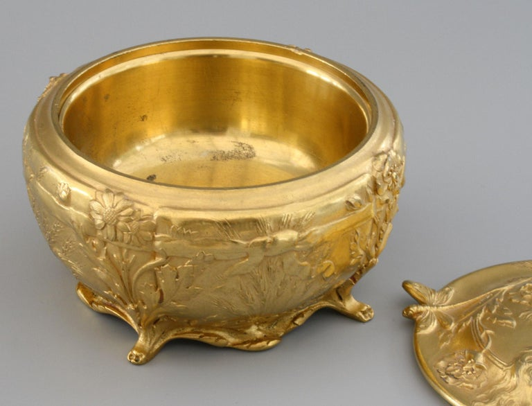 A stunning quality Art Nouveau French richly gilded bronze lidded box designed by C Robinet for Ferdinand Barbedienne (1810-1892) and dating from the latter 19th century. The rounded box stands raised on four paw shaped feet and scroll base edge