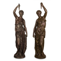 An Important Pair of Monumental Parcel-Gilt and Patinated Bronze Figural Torchèr