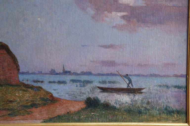 A stunning oil on canvas circa 1910 by sought after French Post Impressionist painter Ferdinand du Puigaudeau depicting a cottage by the sea at dusk with a figure in a boat in the forefront and silhouettes of buildings on the shore beyond the sea in
