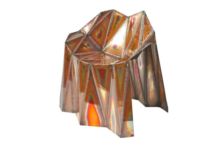The Fernando chair is a welded mirror finish copper work by British artist Julian Mayor. The welding lines create a counterpoint to the mirrored structure and the heat distortion adds a level of depth and interest to the surfaces of the chair.