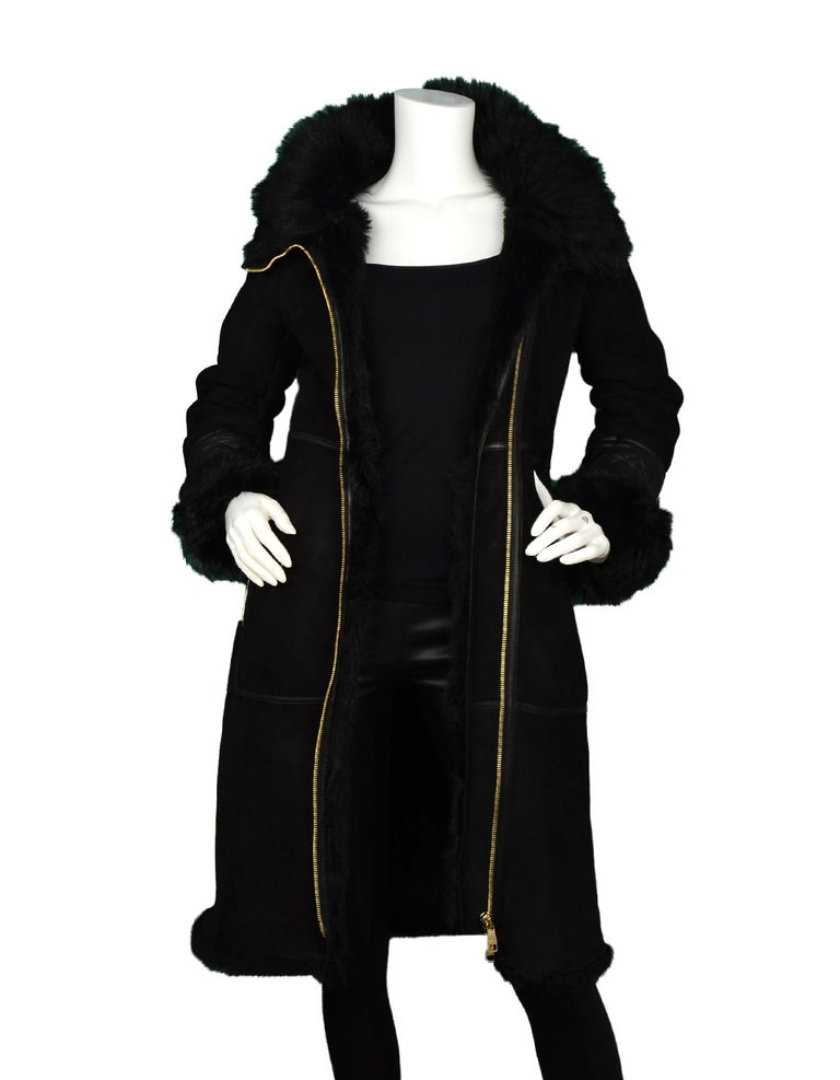 Ferragamo Black Shearling Coat W/ Quilted Leather & Fur Trim Sz US2  Made In: Italy Color: Black Materials: Real leather, lamb shearling  Padding: 100% polyurethane  Opening/Closure: Goldtone two way zipper Overall Condition: Excellent pre-owned