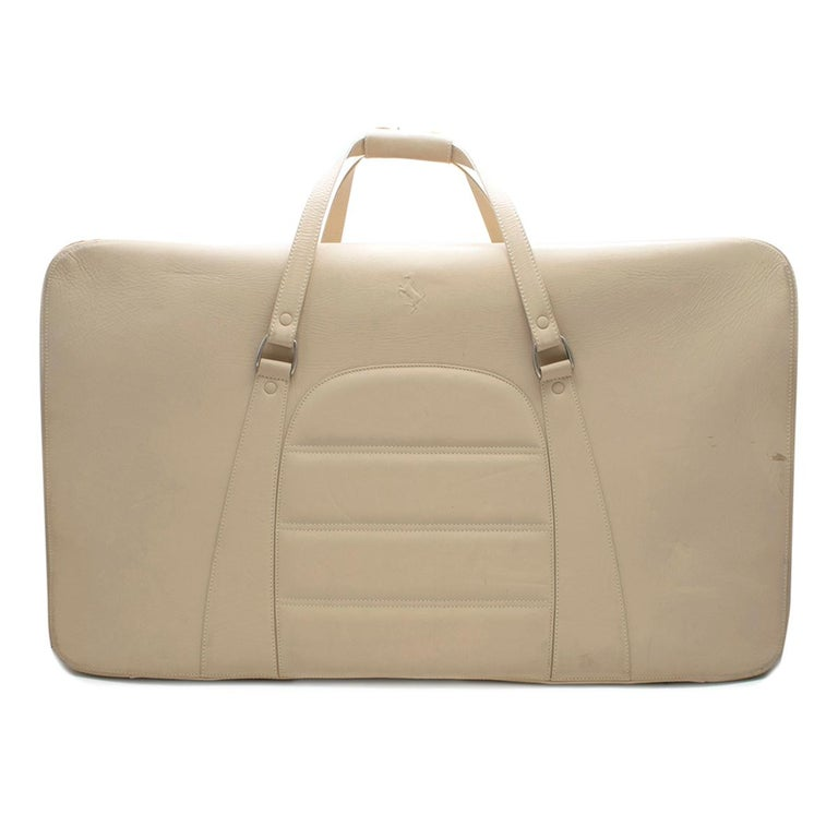 Ferrari Beige Large Leather Suitcase  Custom made Ferrari nude suitcase with a zip fastening. straps inside to hold the clothing in place and protective studs on the bottom.   Please note, these items are pre-owned and may show signs of being stored