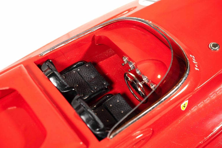 Ferrari Freccia Rossa speed motorboat is a very rare vintage decorative object handcrafted in mahogany wood, metal and leather finishes.  Scale model of the exclusive Ferrari F430-Engined speedboat.  Very good conditions except for some lack of
