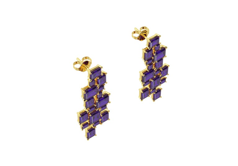 from FERRUCCI a contemporary design featuring emerald cut natural purple amethysts, selected and set in hand made, 18k yellow gold chandelier earrings, for a geometric waterfall of purple crystals, perfect for every season.  These spectacular