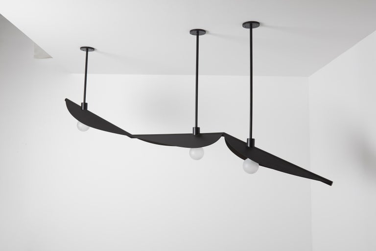 Feuillage trio ceiling mounted Black - Carla Baz Dimensions: L 220 x W 30 x H 85 cm Weight: 15 kg Material: Black steel  Feuillage is a lighting installation composed of fine metal leaves delicately welded on a branch holding frosted glass