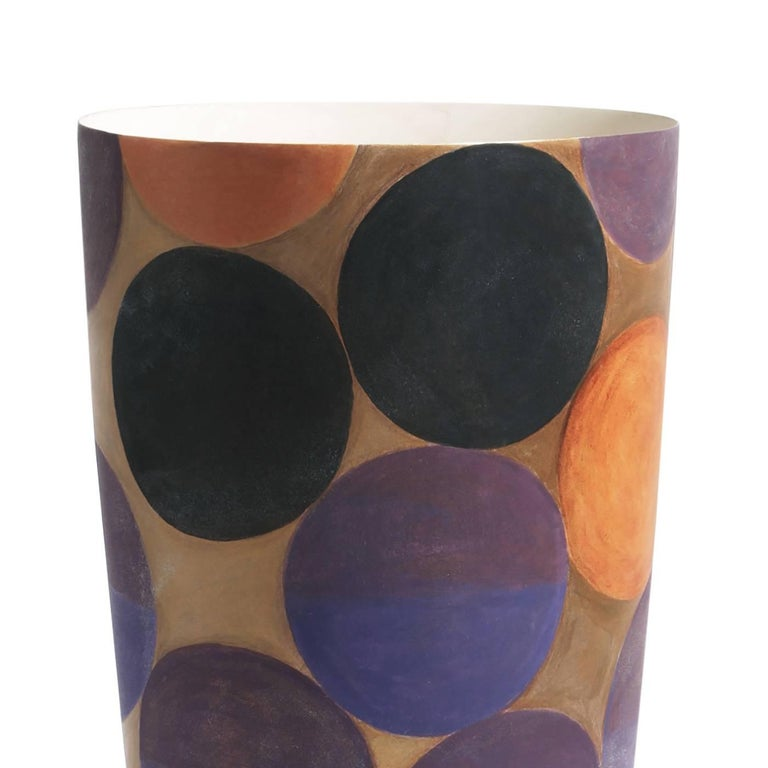 Colorful and playful, this ceramic vase belongs to a limited edition of 50 pieces that were all hand-painted. The simple conic shape of the vase is enriched outside with a series of multicolored large dots in purple, pink, blue, and black almost