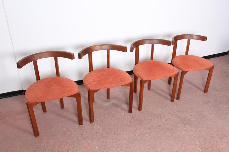 Set of four lovely wooden chairs with red fabric cover, produced in Denmark by FF Caffrance, printed and labeled, in teak. Measures: Height 70 cm, seat width 50 cm, seat depth 45 cm, seat height 43 cm. Wear consistent with age and use.