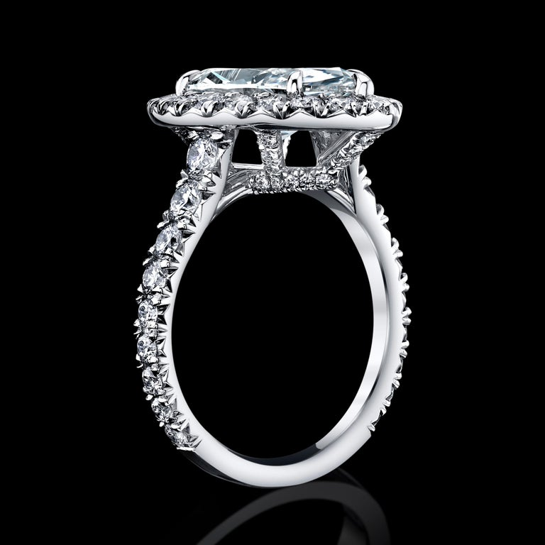 This classic Marquise diamond ring will complement a classy lady.  H color and VS1 clarity with Excellent polish. Wear it to an important event or every day, because it will match all your wardrobe. Set in platinum with 76PCS Radiant Diamonds =