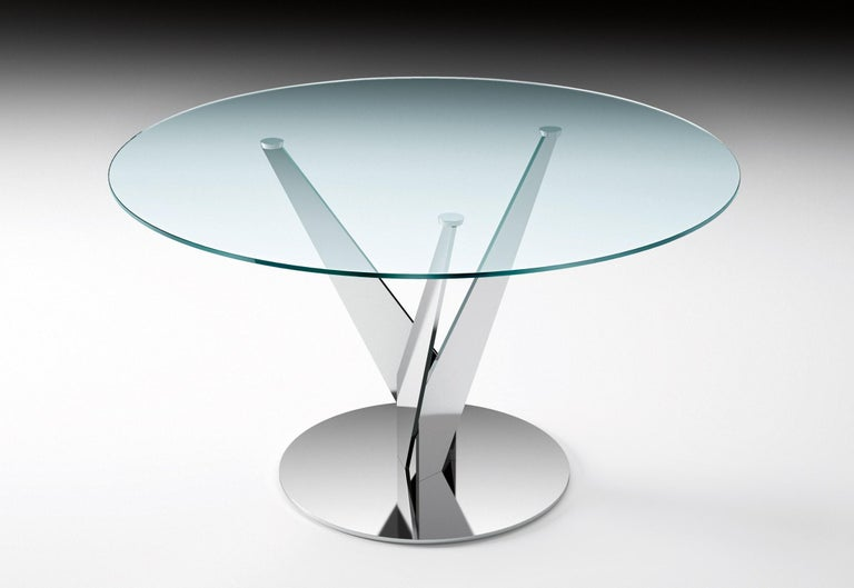 Round table with 10 mm-thick tempered transparent, smoked or bronze glass top. Chromed or burnished brass finish legs; stainless steel or brass fixing plates. The Epsylon table is also available with customized top, diameter from 90cm-140 cm.