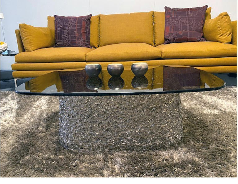 Macrame coffee table bronze comprising hand-interwoven spun glass base and 10 mm-thick glass top. The coffee table collection includes the following finishes: extralight glass top with extralight glass base; bronze glass top with bronze painted
